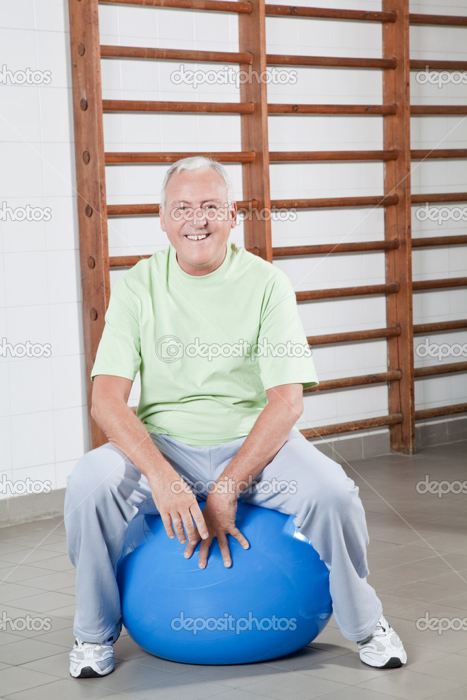 Happy Senior man sits on a fitball. — Stock Photo #11203132