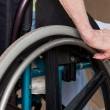 Woman's Hands on Wheelchair — Stock Photo