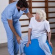 Physical Therapist helping a Patient - Stock Photo