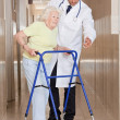 Doctor helping Patient use Walker — Stock Photo