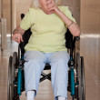 Retired Woman on Wheelchair - Stock Photo