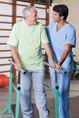 Senior Man having ambulatory therapy — Stock Photo