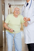 Doctor Assisting Senior Woman — Stockfoto