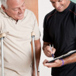 Stock Photo: Patient on Crutches and Physician
