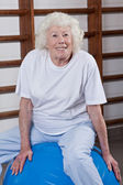Senior Woman Sits on a Fitball — Stock Photo