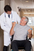Doctor with Patient on Wheel Chair — Stock Photo