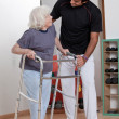 Therapist helping Patient use Walker — Stock Photo #11535815