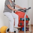 Stock Photo: Female Doing Physical Exercise