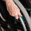 Hand On Wheelchair - Stock Photo