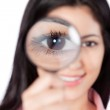 Woman Holding Magnifying Glass — Stock Photo #11536445