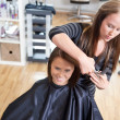 Hairdresser Cutting Client's Hair — Stock Photo