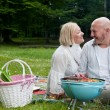 Happy Couple in Park with Barbecue — Stock Photo