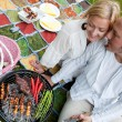 Happy Couple with BBQ in Park — Stock Photo #11536743