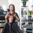 Stylist Drying Woman's Hair — Stockfoto