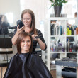 Stylist Drying Woman's Hair — Lizenzfreies Foto
