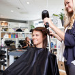 Hairdresser Drying Customer's Hair — Stock Photo