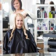 Hairdresser Curling Young Woman's Hair — Stock Photo