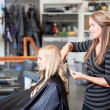 Stockfoto: Stylist Curling Womans Hair