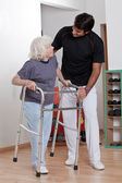 Therapist helping Patient use Walker — Stock Photo