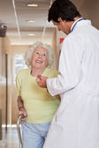 Doctor helping Patient use Walking Stick — Stock Photo