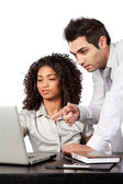 Businessman and Businesswoman Using Laptop — Stock Photo