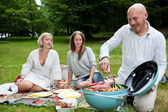Friends with BBQ picnic in Park — Stock Photo