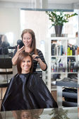Stylist Drying Woman's Hair — Stock Photo