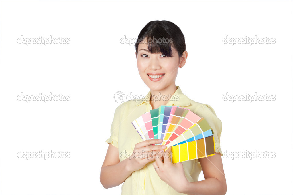 Happy young woman  showing color chart isolated on white background. — Stock Photo #11536117