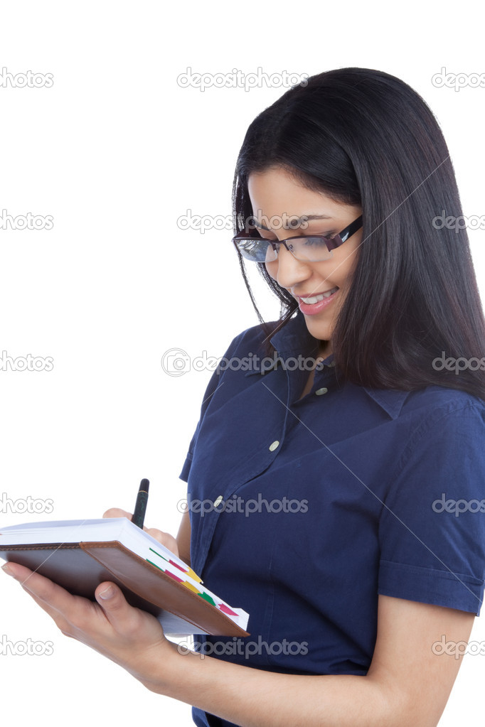 Close-up of businesswoman making note on notebook isolated on white background. — Stock Photo #11536231