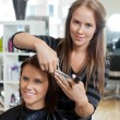 Stylist Giving a Haircut To Woman — Stock Photo