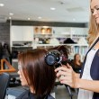 Woman Getting Her Hair Styled — Stock Photo #11659664