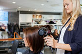 Woman Getting Her Hair Styled — Stock Photo