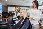 Woman Having Her Hair Styled — Stock Photo