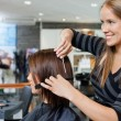 Stock Photo: Hairdresser Giving a Haircut To Woman