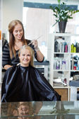 Woman Getting Hair Highlighted — Stock Photo