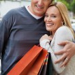 Royalty-Free Stock Photo: Cheerful Couple With Shopping Bags