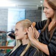 Hairdresser Combing Hair Of Female — Stock Photo #11683600