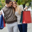 Stock Photo: Couple Walking Leisurely On Sidewalk