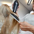 Hairdresser Blow Drying Hair Of Female — Stock Photo