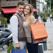 Cheerful Couple With Shopping Bags - Stock Photo