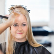 Woman Getting Hair Combed — Stock Photo