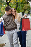 Couple Walking Leisurely On Sidewalk — Stock Photo