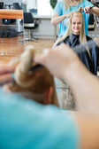 Female Customer Getting Hairdo At Salon — Stock Photo