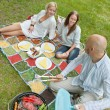Friends Eating Food At An Outdoor Picnic — Stock Photo