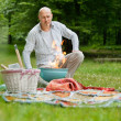 Man At An Outdoor Picnic - Stock Photo