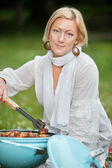 Female Preparing Food On Barbecue — Stock Photo