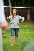 Young Female Playing Badminton — Stock Photo