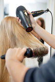 Stylist Drying Woman's Hair In Hairdresser Salon — Stock Photo