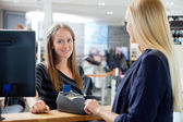 Female Sales Clerk At Counter — Stock Photo