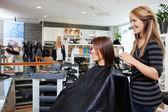 Hair Dresser with Customer in Beauty Salon — Stock Photo